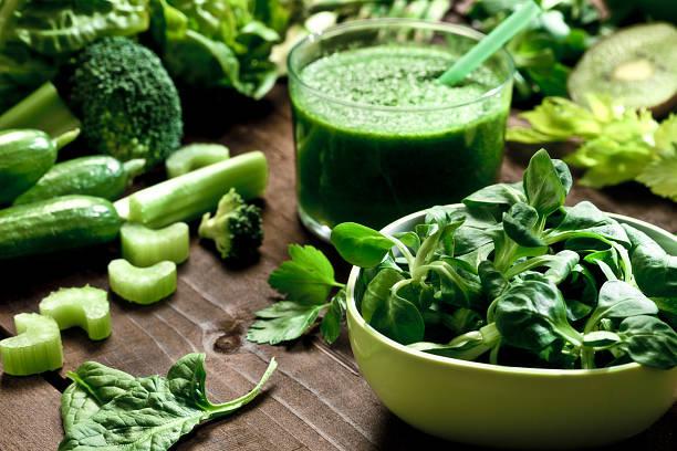 Detox diet concept: green vegetables on wooden table:スマホ壁紙(壁紙.com)
