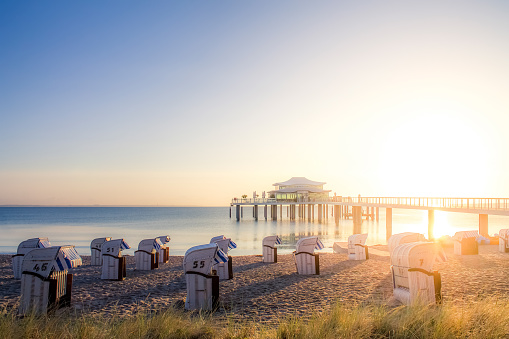 Baltic Sea「Germany, Niendorf, view to Timmendorfer Strand with hooded beach chairs and sea bridge」:スマホ壁紙(8)