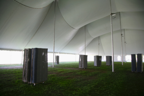 Entertainment Tent「Stacks of folding chairs inside marquee」:スマホ壁紙(8)