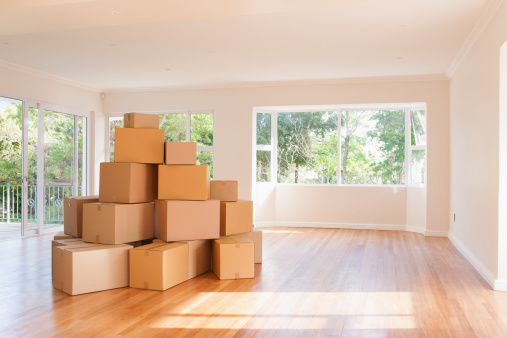 Cardboard Box「Boxes stacked in living room of new house」:スマホ壁紙(1)