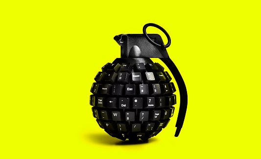 Threats「cyber attack grenade on yellow background」:スマホ壁紙(3)