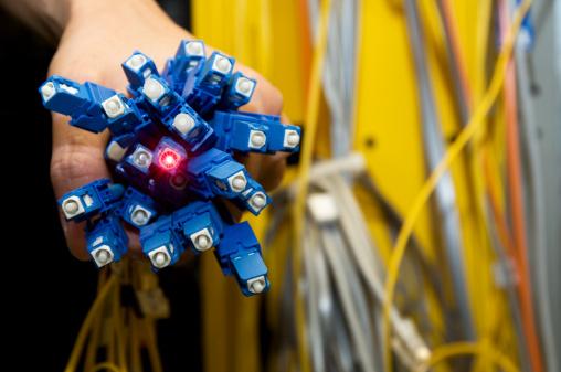 Engineer「Electrical engineer holding a bunch of fiber optics」:スマホ壁紙(1)