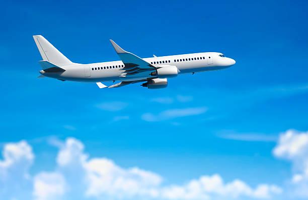 Modern passanger airplane flying above clouds.:スマホ壁紙(壁紙.com)
