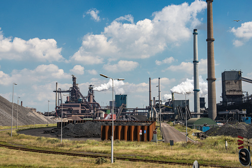Ijmuiden「Steel mill with smoking chimneys and heaps of raw material」:スマホ壁紙(3)