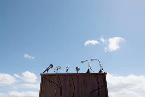Anticipation「Microphones on lectern, outdoors, low angle view」:スマホ壁紙(9)