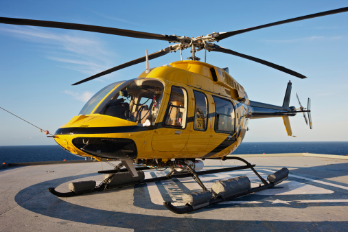 Helicopter「A Bell 407 utility helicopter on the helipad of an oil rig.」:スマホ壁紙(5)