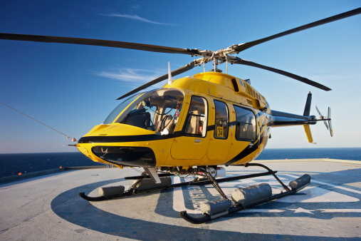 Helicopter「A Bell 407 utility helicopter on the helipad of an oil rig.」:スマホ壁紙(4)