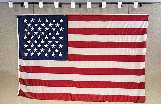 Fourth of July「Large American Flag hanging on wall, illuminated with Spotlights.」:スマホ壁紙(6)