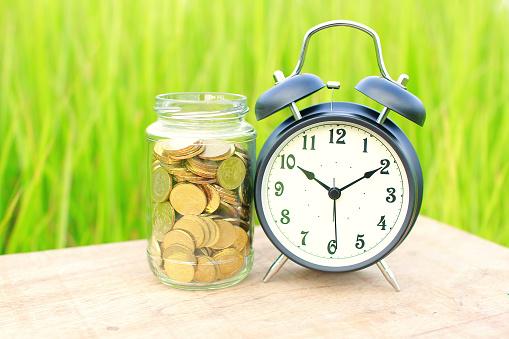 Bell「Alarm clock on a table next to a jar」:スマホ壁紙(11)
