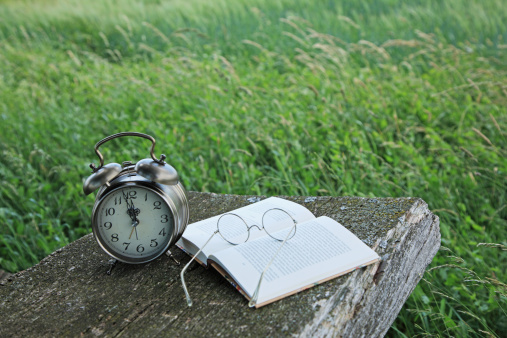 Eyeglasses「Alarm clock, glasses and a book on a picnic table」:スマホ壁紙(8)