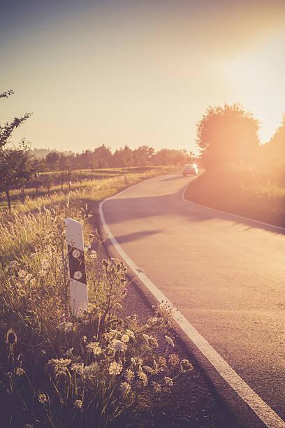 Driving car on country lane at evening twilight:スマホ壁紙(壁紙.com)