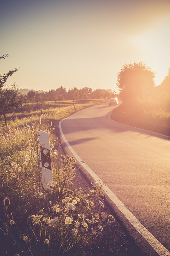 Back Lit「Driving car on country lane at evening twilight」:スマホ壁紙(1)