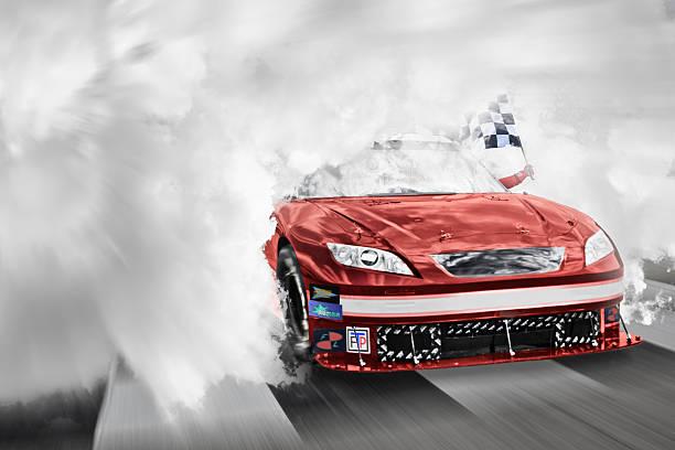 Winning Nascar driver breaking through smoke.:スマホ壁紙(壁紙.com)