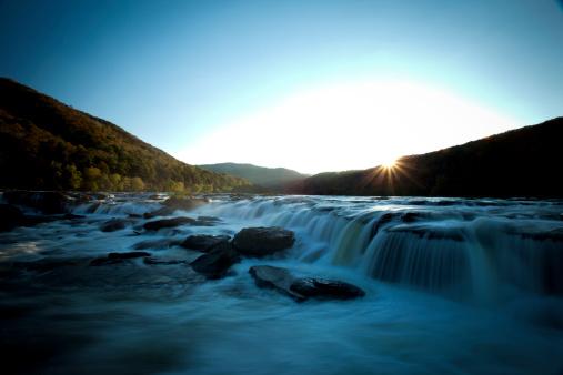 Waterfall「Wide waterfall seen in evening light with blurry water.」:スマホ壁紙(15)