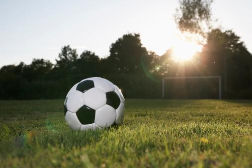Twilight「Germany, Cologne, Soccer ball on football field」:スマホ壁紙(0)