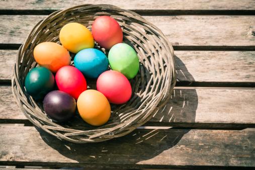 イースター「Germany, Colorful Easter eggs on wooden table」:スマホ壁紙(1)