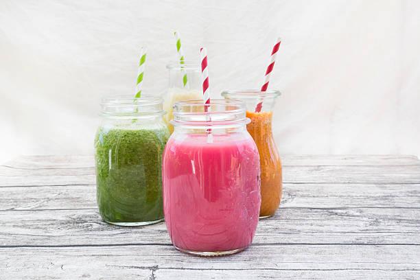 Four glasses of different smoothies:スマホ壁紙(壁紙.com)