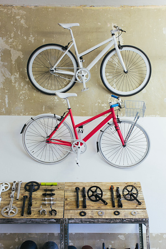 Individuality「Two custom-made bicycles hanging on the wall in a store」:スマホ壁紙(13)