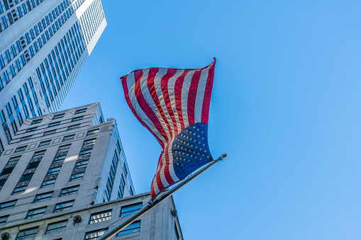 star sky「The American National Flag is swaying by wind among the building at Midtown Manhattan New York City.」:スマホ壁紙(12)
