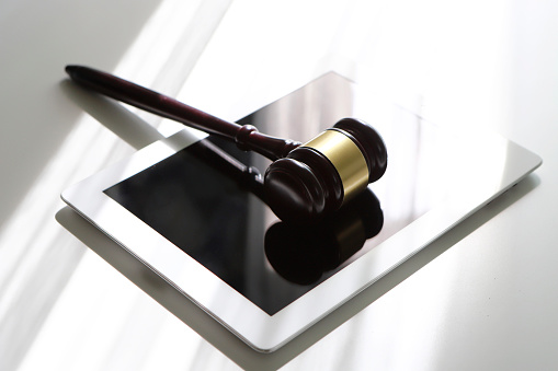 Legislation「Gavel on digital tablet」:スマホ壁紙(14)
