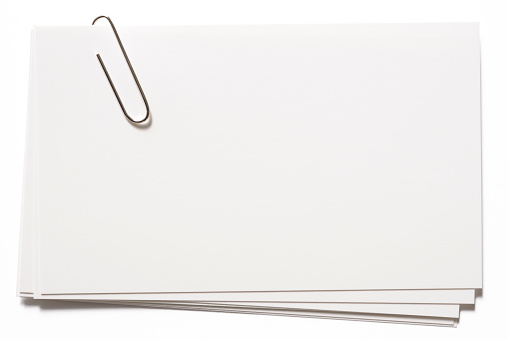 Message「Stacked blank white cards with paper clip on white background」:スマホ壁紙(19)