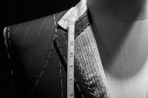 Tailor「Man wearing a suit close-up with tape measure around neck」:スマホ壁紙(7)
