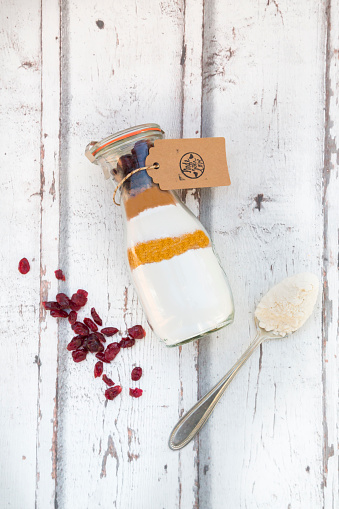 Cocoa「Glass bottle with ingredients of baking mix for cranberry chocolate cake」:スマホ壁紙(5)