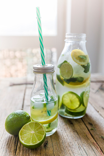 Drinking Straw「Glass bottles of infused water with lemon, lime, mint leaves and ice cubes」:スマホ壁紙(7)