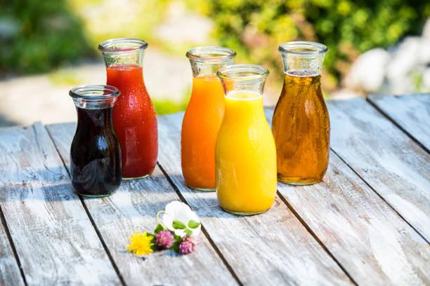 Glass bottles of various fruit juices:スマホ壁紙(壁紙.com)