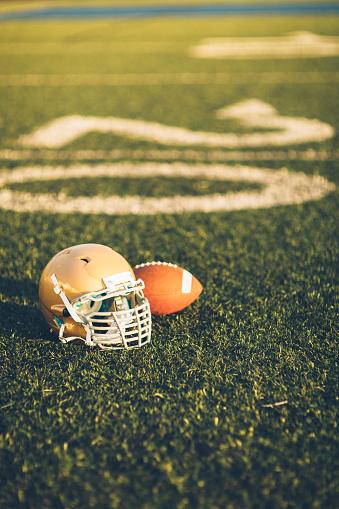 Competitive Sport「Gold Football Helmet on Field」:スマホ壁紙(13)