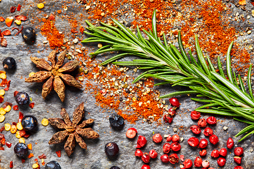Star Anise「Flat lay of various spices and herbs on slate background」:スマホ壁紙(8)