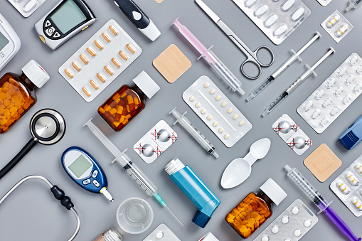 Medical Equipment「Flat lay of various medical supplies on gray background」:スマホ壁紙(6)