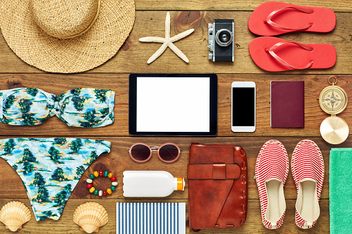 Suntan Lotion「Flat lay of tablet computer surrounded with beach travel accesso」:スマホ壁紙(18)