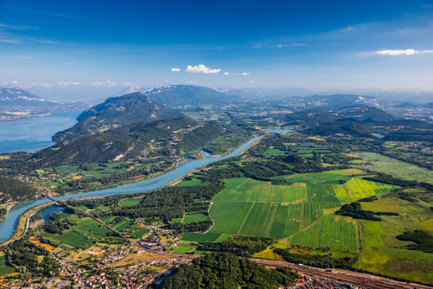 Beautiful hilly French landscape aerial view in middle of Bugey mountains in Ain department near Savoie, with Rhone River, vibrant green fields and famous Lake Bourget not far, shot in summer:スマホ壁紙(壁紙.com)