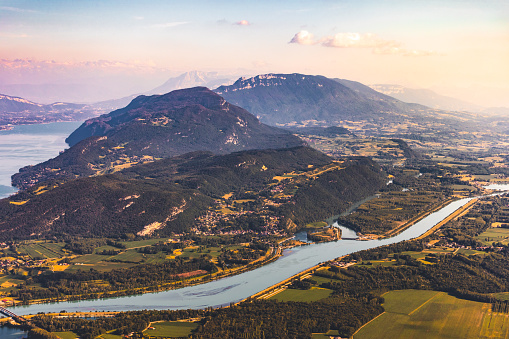 Lake Bourget「Beautiful hilly French landscape at sunset aerial view in middle of Bugey mountains in Ain department near Savoie, with Rhone River, fields and Lake Bourget not far, shot in summer」:スマホ壁紙(11)