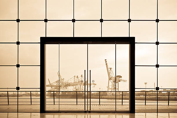 Hamburg Docks framed by modern glass doorway:スマホ壁紙(壁紙.com)