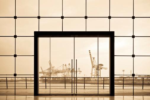 Sepia Toned「Hamburg Docks framed by modern glass doorway」:スマホ壁紙(2)