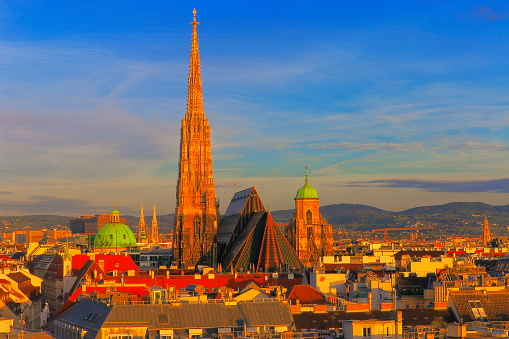 Austria「Above Vienna Cityscape and St. Stephen's Cathedral roof, urban skyline at sunset – Vienna , Austria」:スマホ壁紙(1)