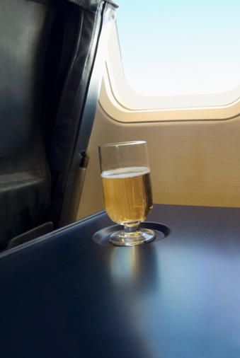 First Class「Glass of champagne on table in airplane」:スマホ壁紙(17)
