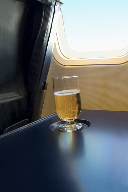 Glass of champagne on table in airplane:スマホ壁紙(壁紙.com)
