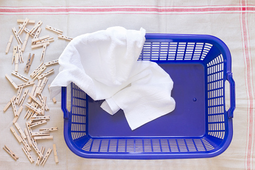 Clothespin「Clothes pegs, laundry basket and towel on cloth」:スマホ壁紙(2)