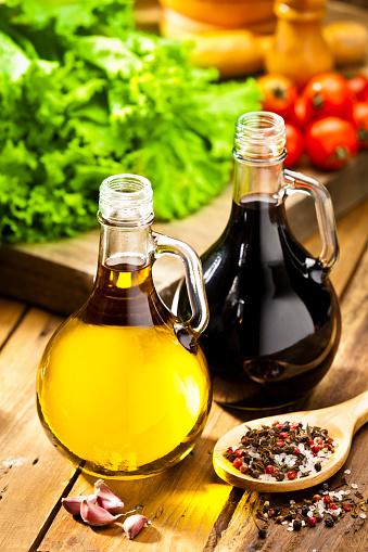 Vinaigrette Dressing「Oil and vinegar bottles on rustic wood table」:スマホ壁紙(13)