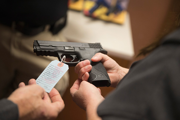 Law「Gun Shop Near Ferguson Sees Increase In Business Ahead Of Awaited Grand Jury Decision」:写真・画像(17)[壁紙.com]