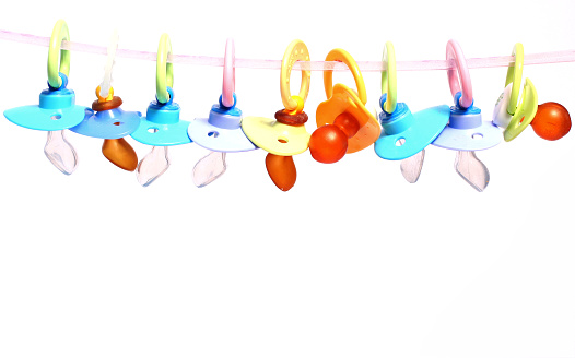 Pacifier「Many baby pacifiers hanging from a string」:スマホ壁紙(17)