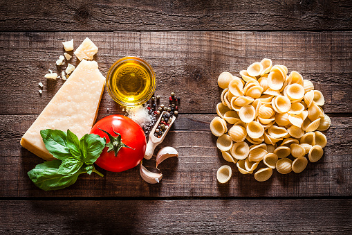 Garlic Clove「Orecchiette pasta with ingredients on rustic wooden table」:スマホ壁紙(8)