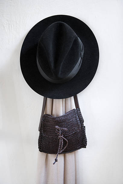 A hat, a bag and a scarf hanging on a wall.:スマホ壁紙(壁紙.com)