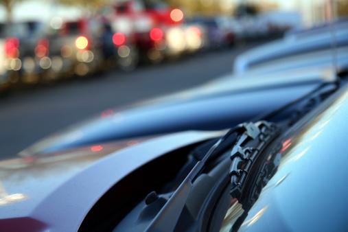 Car Dealership「New Car's Windshield Wiper At A Car Lot.」:スマホ壁紙(4)