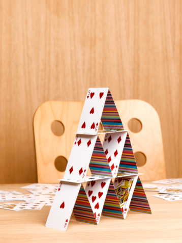 Pyramid Shape「Stack of playing cards on desk, close-up」:スマホ壁紙(14)