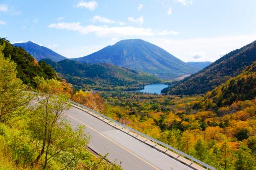 Nikko City「Mt. Nantai and Road in autumn, Tochigi Prefecture, Honshu, Japan」:スマホ壁紙(6)