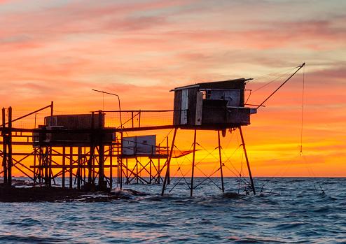 Nouvelle-Aquitaine「Carrelet fishing huts on stilts at sunset near La Rochelle France」:スマホ壁紙(1)